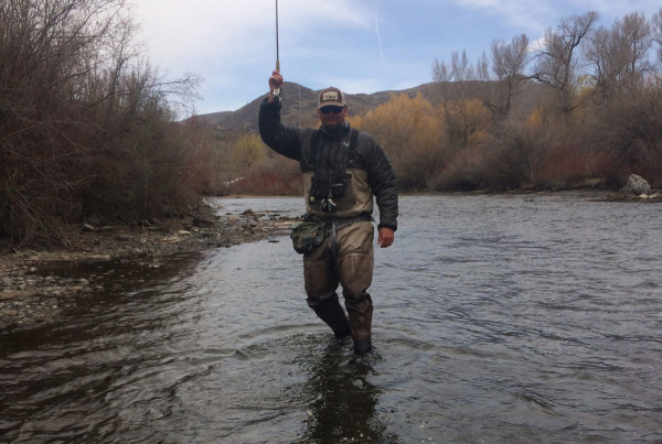 A man fly-fishing at Homestead Resort in Midway, Utah.