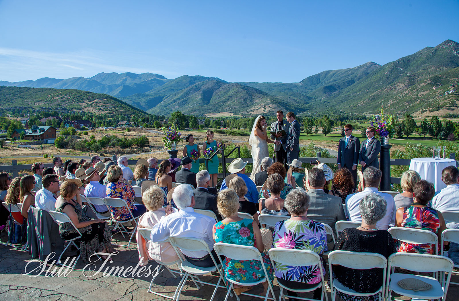 Bride and Groom in front of guests sitting on the top of the Homestead Crate an ideal wedding venue in Utah