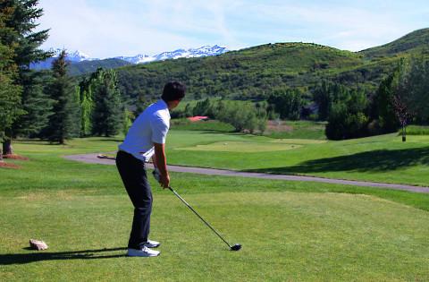 Man golfing at Crater Springs Golf Course at Homestead Resort in Heber, Utah.