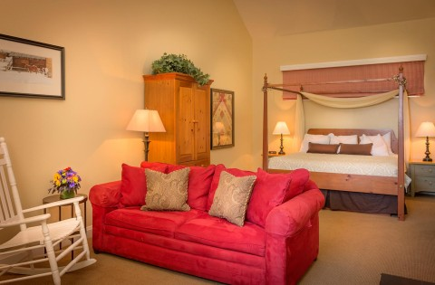 Large guest bed and couch in one of our Midway Utah hotel rooms