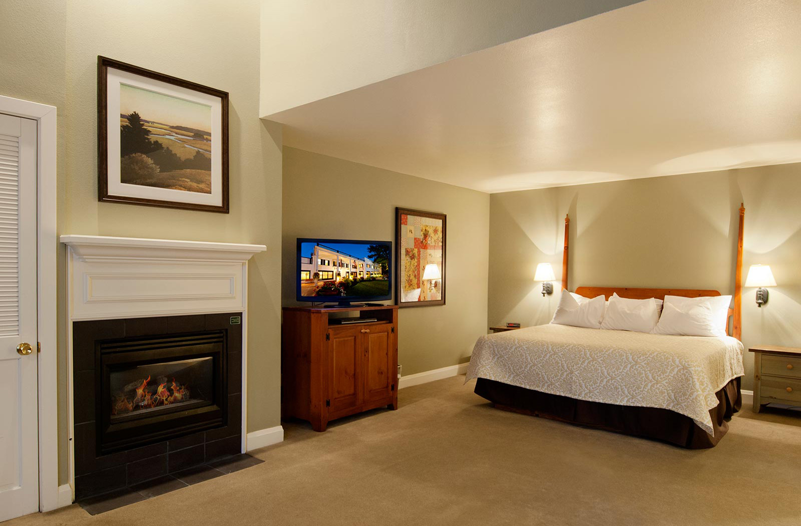 Spacious luxury suite guest room with king bed, gas fireplace and tv at our Homestead Resort in Heber City