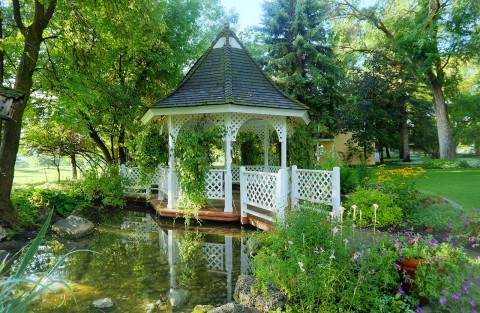 Lush green setting with fish pond and beautiful white gazebo at The Homestead Resort in Midway, Utah
