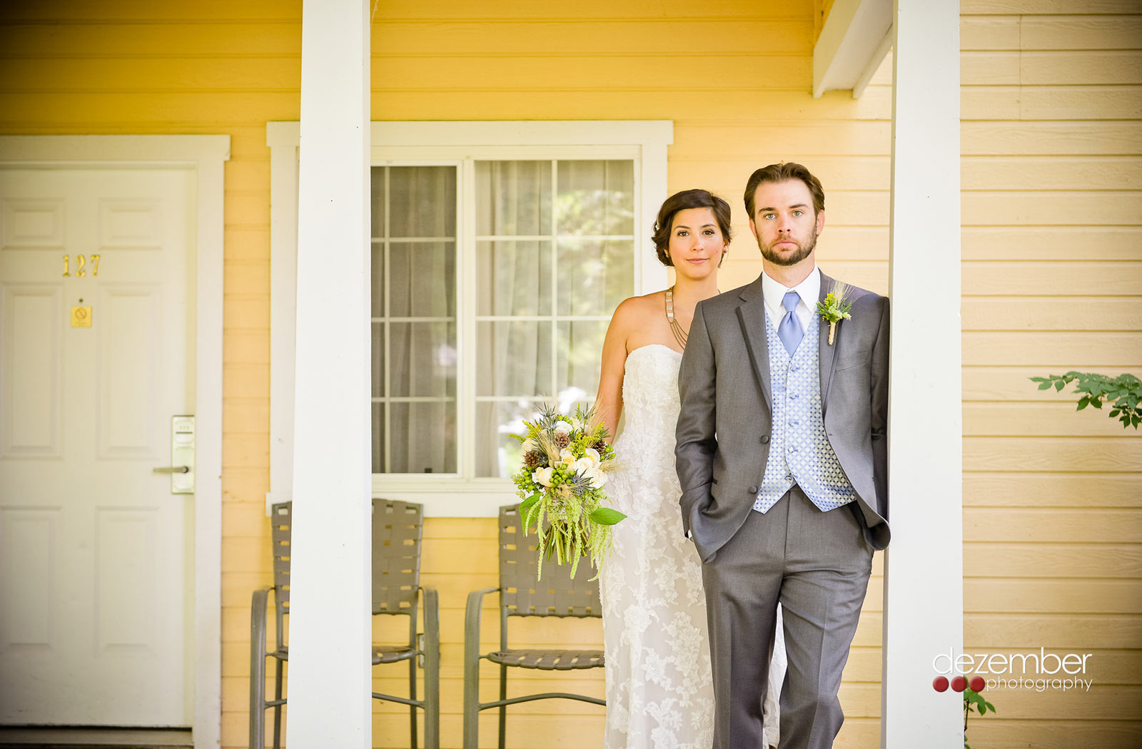 Couple in front of a yellow exterior building at the homestead an ideal Utah wedding venue