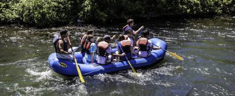 A group enjoying a day on the river doing a rafting trip near The Homestead Resort