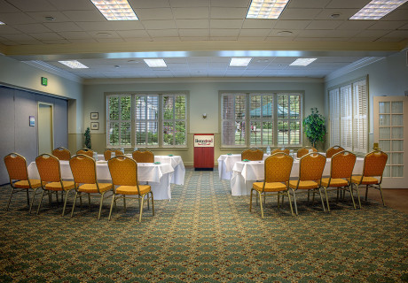 Midway Utah meeting Venue with lined tables & chairs in front a podium at the Homestead Resort