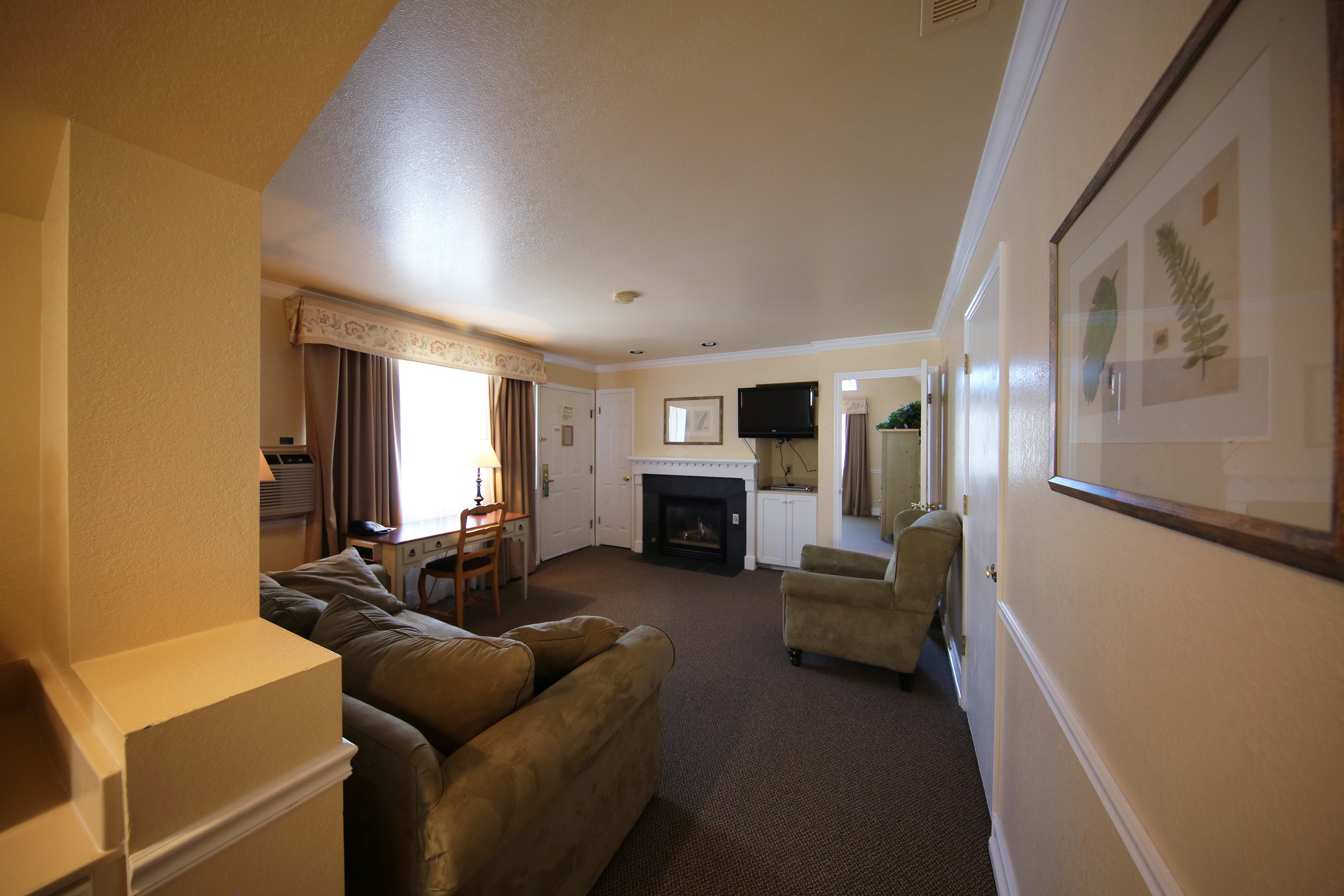 Living room with private fireplace in the King Suite of our Midway Utah hotel