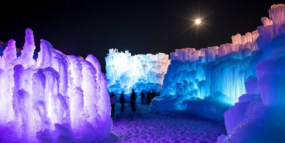 Full Formed Ice Castles at Night with a full moon at the Homestead Resort