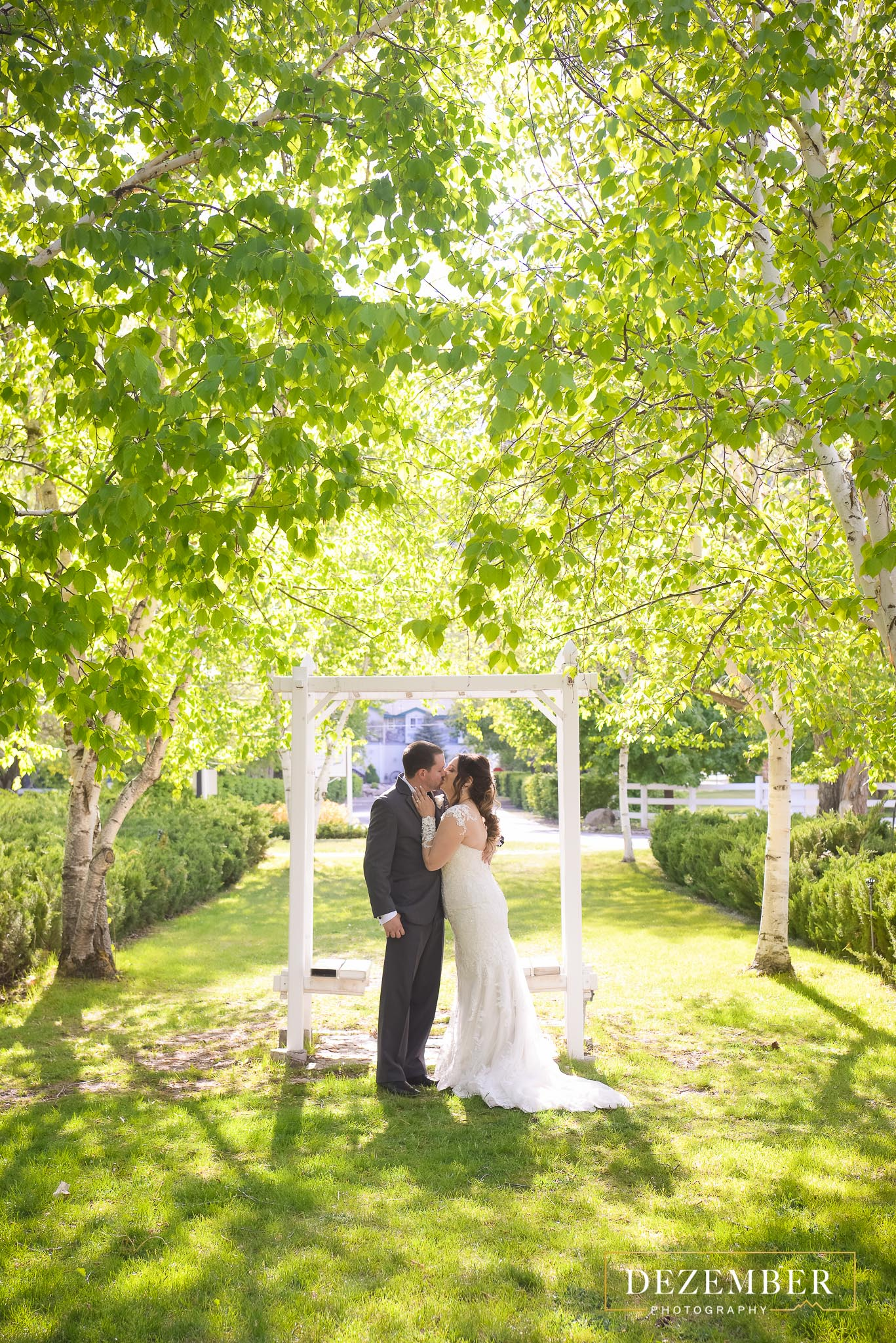 Bride and Groom Kissing in the Sun at The Homestead Reosrt Lawn