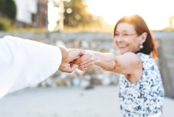 Older woman holds the hand of a man while on a romantic getaway at our Utah resort